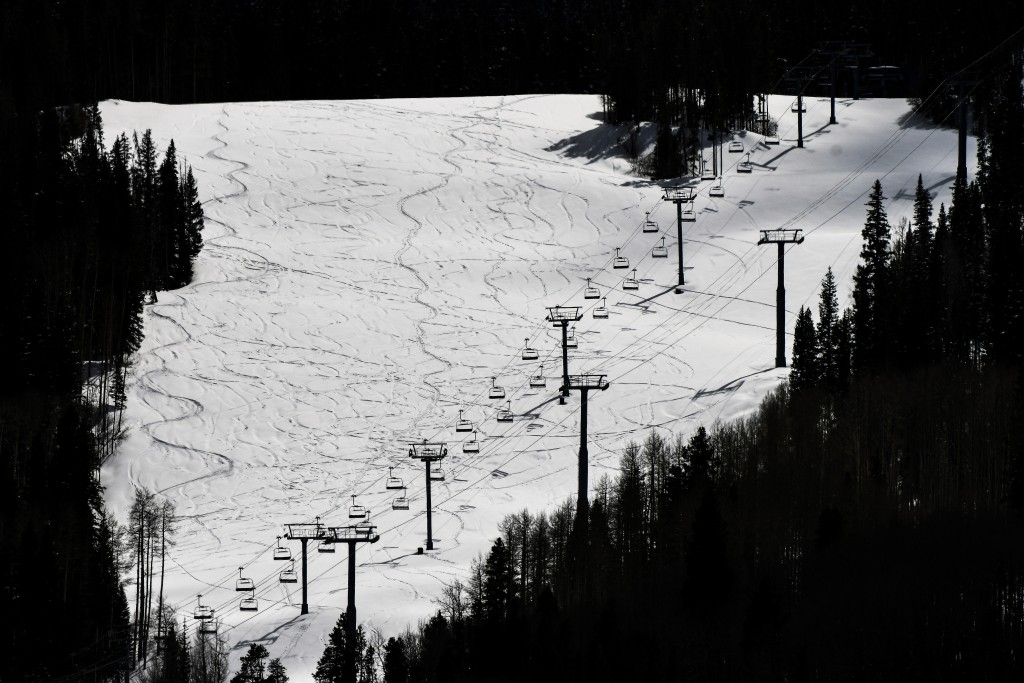 This Tuesday, March 24, 2020 photo shows ski lifts empty in Vail, Colo., after Vail Ski Resort closed for the season amid the COVID-19 pandemic. The c...
