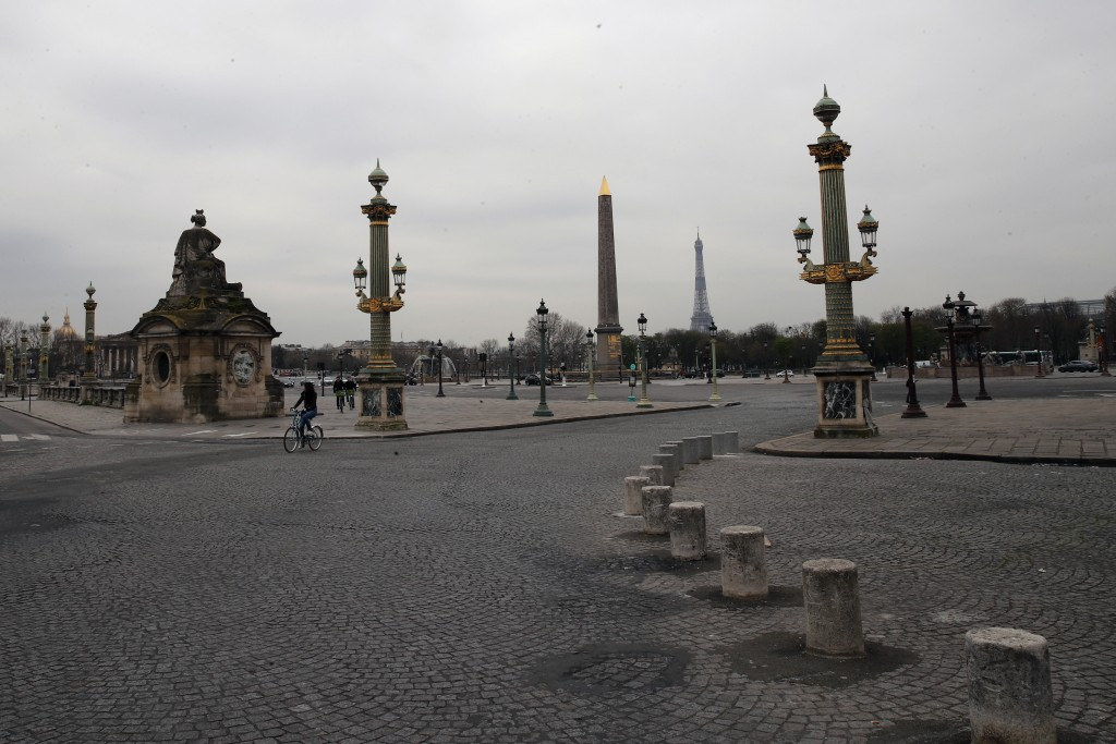 FILE - In this March 17, 2020 file photo, the deserted Place de la Concorde after nationwide confinement measures came into effect, in Paris. The conf...