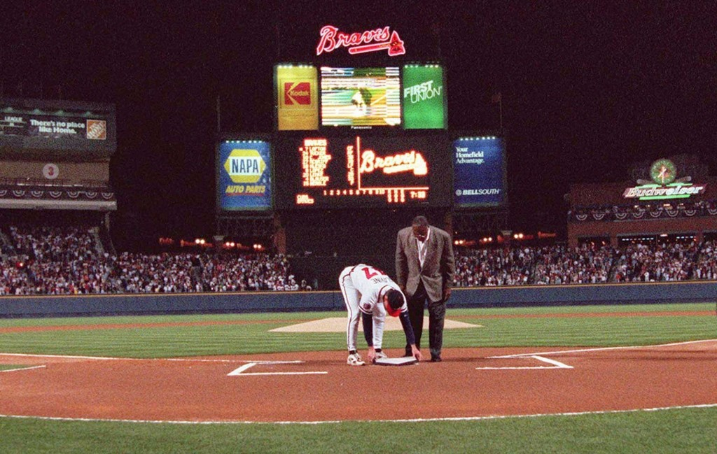 FILE - In this April 4, 1997, file photo, former Atlanta Braves great Hank Aaron looks on as pitcher Tom Glavine places down home plate from Atlanta F...