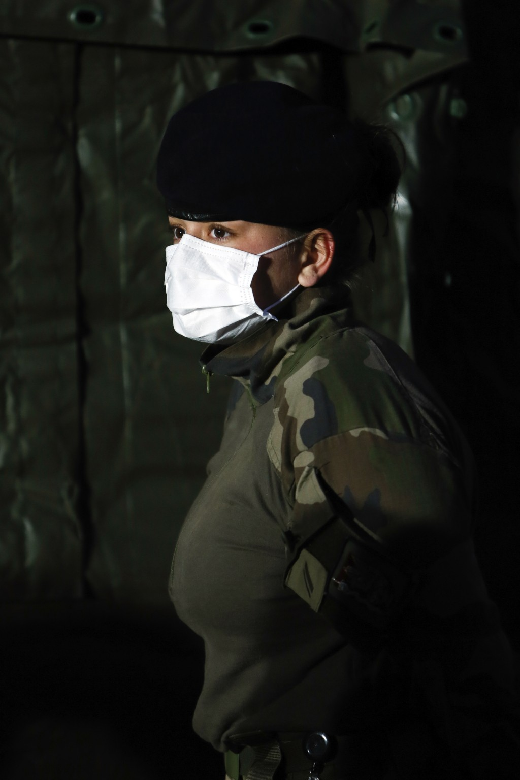 A soldier wears a face mask at the military field hospital in Mulhouse, eastern France, Wednesday, March 25, 2020. French President Emmanuel Macron la...