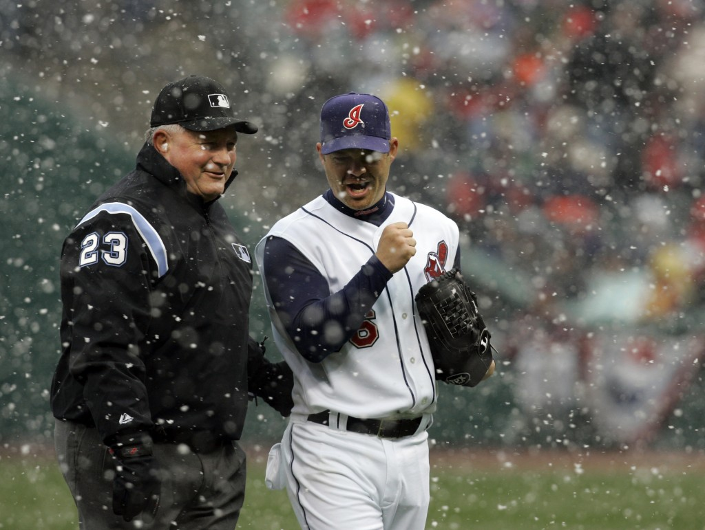 FIULE - In this April 6, 2007, file photo, umpire Rick Reed (23) laughs with Cleveland Indians pitcher Paul Byrd (36) after snow delayed the baseball ...