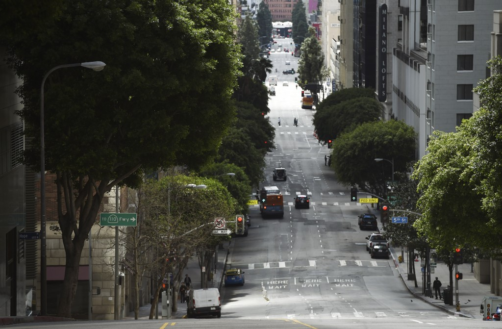 Traffic is light on Grand Avenue in downtown Los Angeles as stay-at-home orders due to coronavirus continue in the city, Wednesday, March 25, 2020. (A...