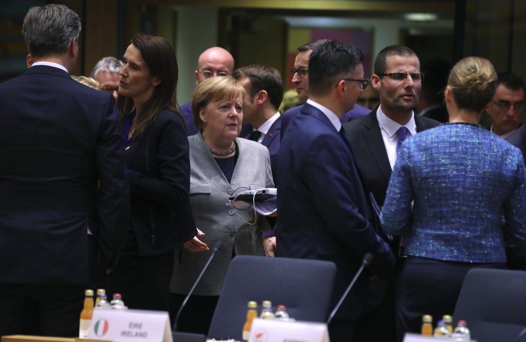 FILE - In this Feb. 21, 2020 file photo, German Chancellor Angela Merkel, center, arrives for a round table meeting at an EU summit in Brussels. Europ...