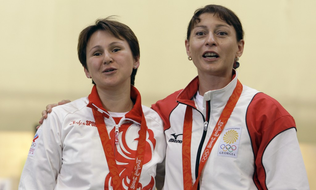 FILE - In this Sunday, Aug. 10, 2008 file photo, Russia's Natalia Paderina, left, and Georgia's Nino Salukvadze embrace after the women's 10 meter air...