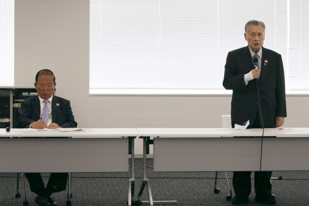 """Tokyo 2020 Organizing Committee President Yoshiro Mori, right, speaks as CEO Toshiro Muto listens during the the first meeting of  the """"Tokyo 2020 New..."""