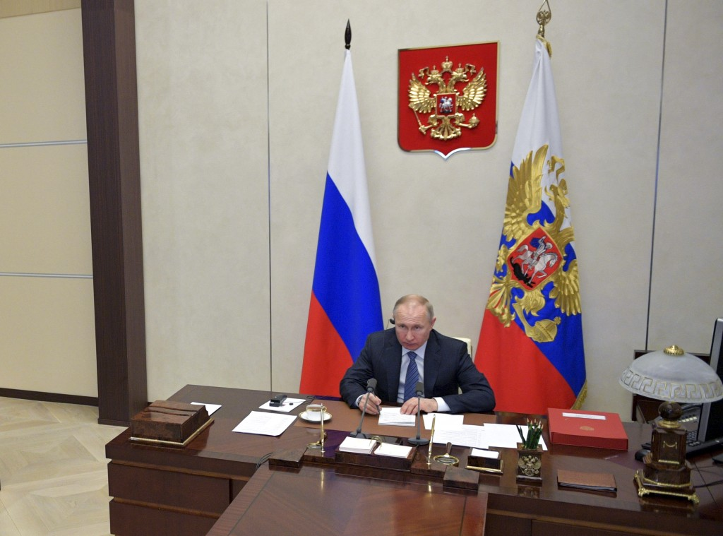 Russian President Vladimir Putin attends a videoconference with G20 leaders to discuss the coronavirus disease outbreak, at the Novo-Ogaryovo residenc...