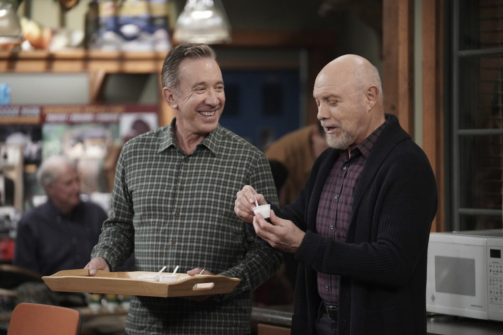 "This image released by Fox shows Tim Allen, left, and Hector Elizondo in a scene from the comedy series ""Last Man Standing,"" that aired on Thursday, M..."
