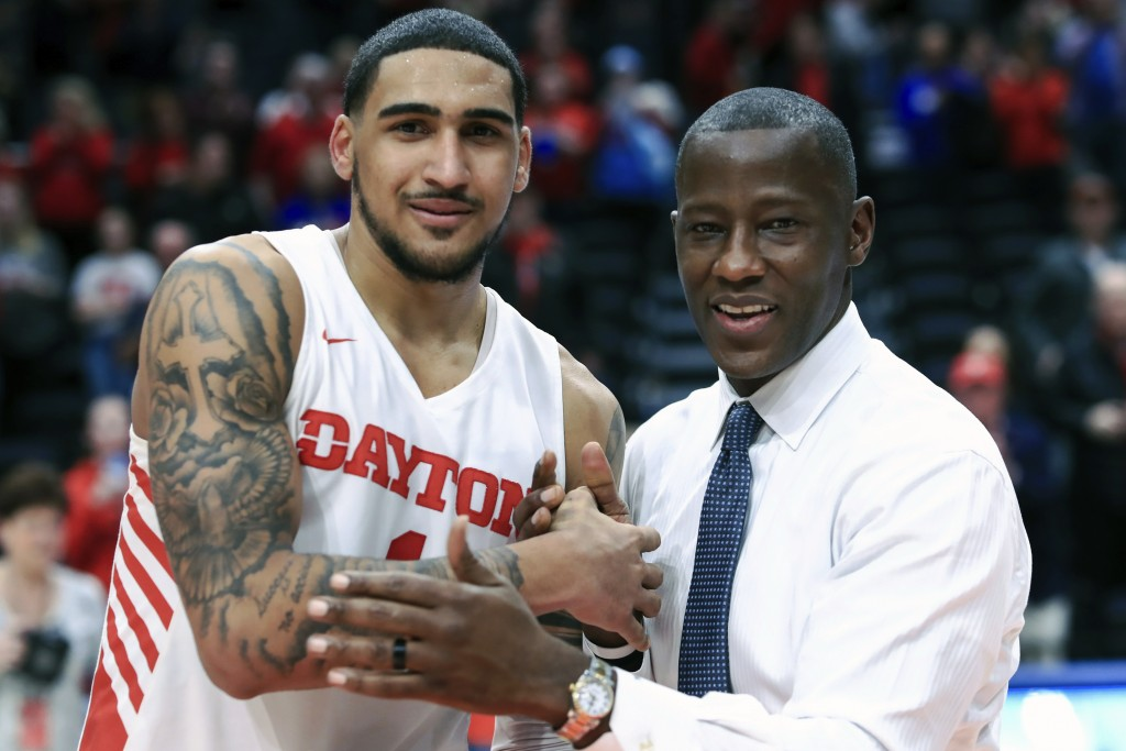 FILE - In this Feb. 22, 2020, file photo, Dayton's Obi Toppin, left, celebrates scoring his 1,000th career point with head coach Anthony Grant after a...
