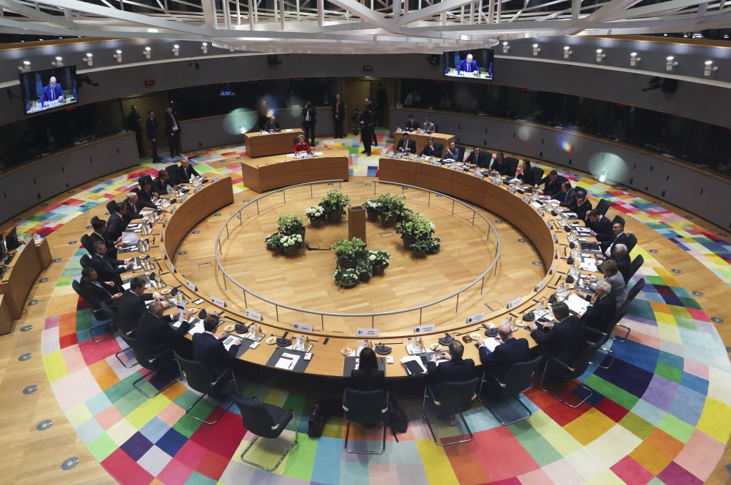 FILE - In this Feb. 21, 2020 file photo, European Union leaders meet at a round table during an EU summit in Brussels. European Union leaders are conv...