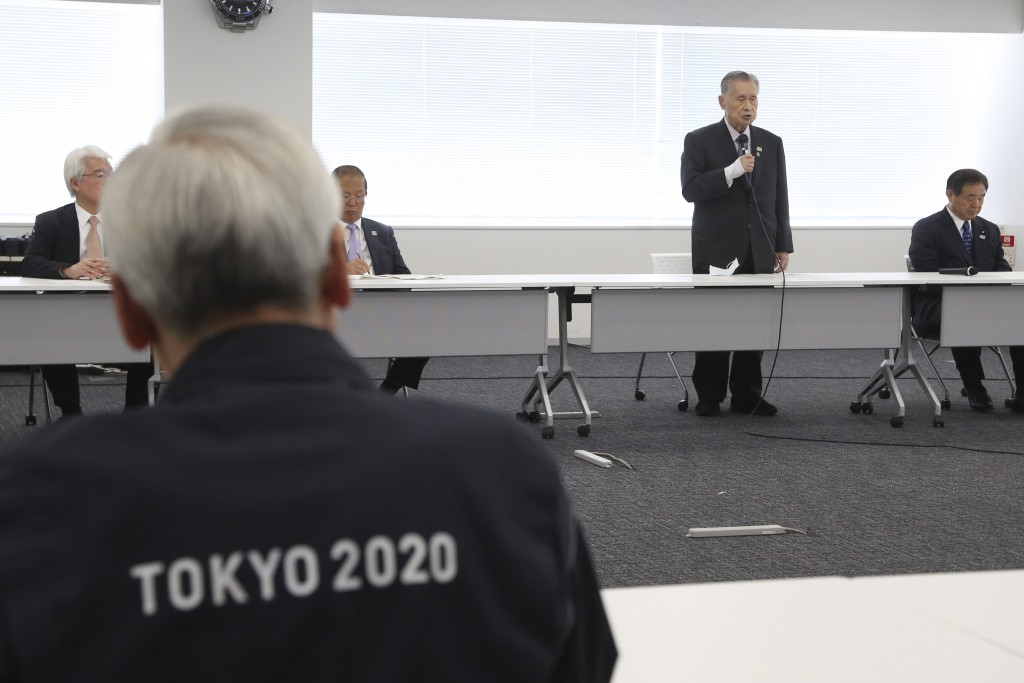 """Tokyo 2020 Organizing Committee President Yoshiro Mori, center at rear, speaks during the first meeting of the """"Tokyo 2020 New Launch Task Force"""" in T..."""