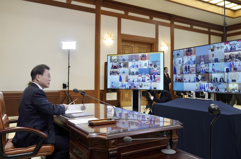 In this photo provided by South Korea Presidential Blue House via Yonhap News Agency, South Korean President Moon Jae-in attends G-20 virtual summit t...