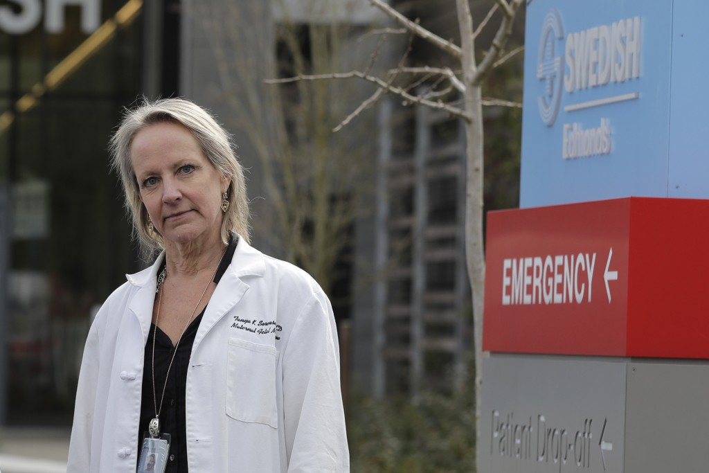 In this Tuesday, March 24, 2020, photo, Dr. Tanya Sorensen, a practicing maternal fetal medicine physician at Swedish Medical Center, and executive di...