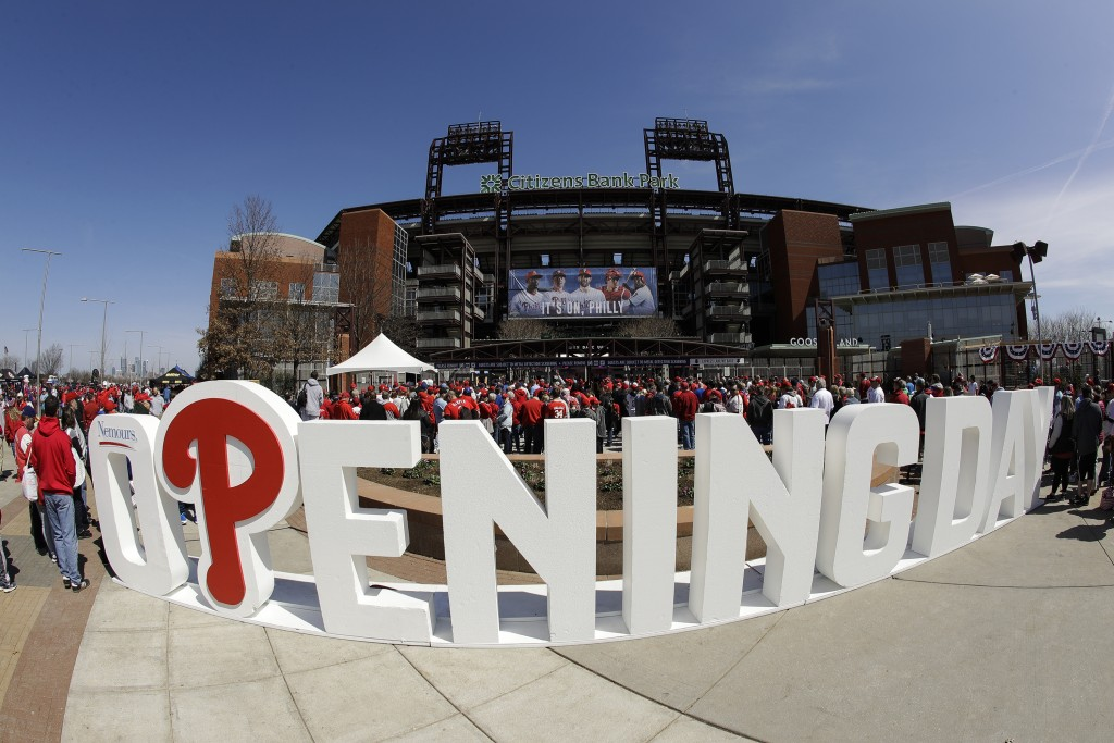 FILE - In ths March 28, 2019, file photo, fans gather for the Philadelphia Phillies opening day baseball game against the Atlanta Braves at Citizens B...