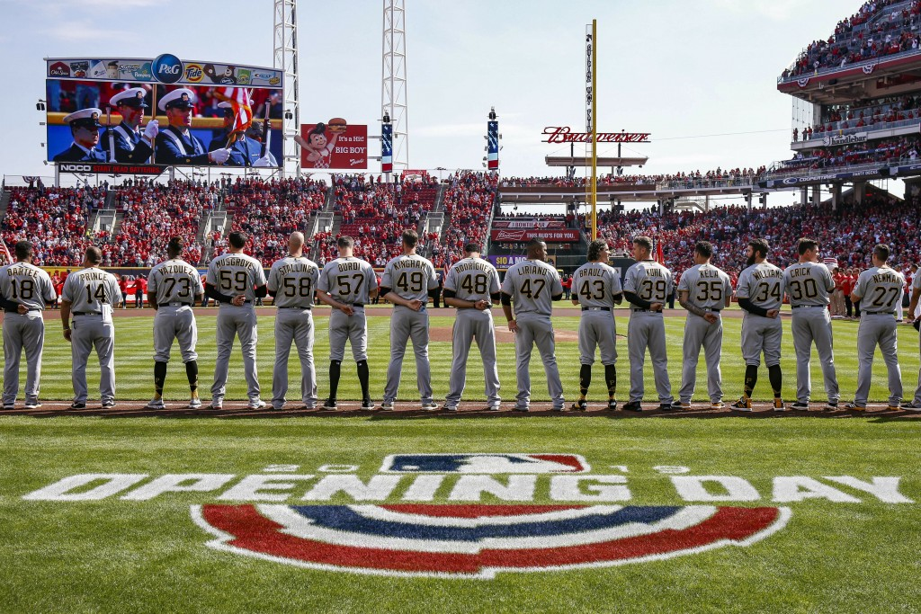 FILE - In this March 28, 2019, file photo, the Pittsburgh Pirates lineup for the national anthem before an opening day baseball game against the Cinci...