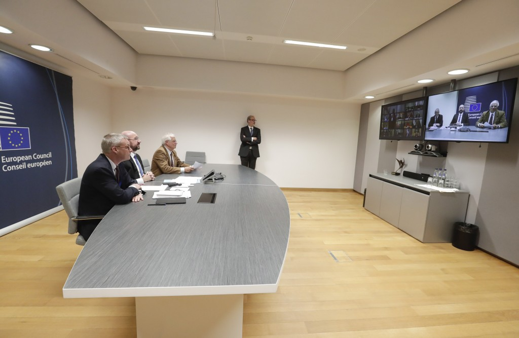 FILE - In this Tuesday, March 10, 2020 file photo, European Council President Charles Michel, second left, participates in a video conference call wit...