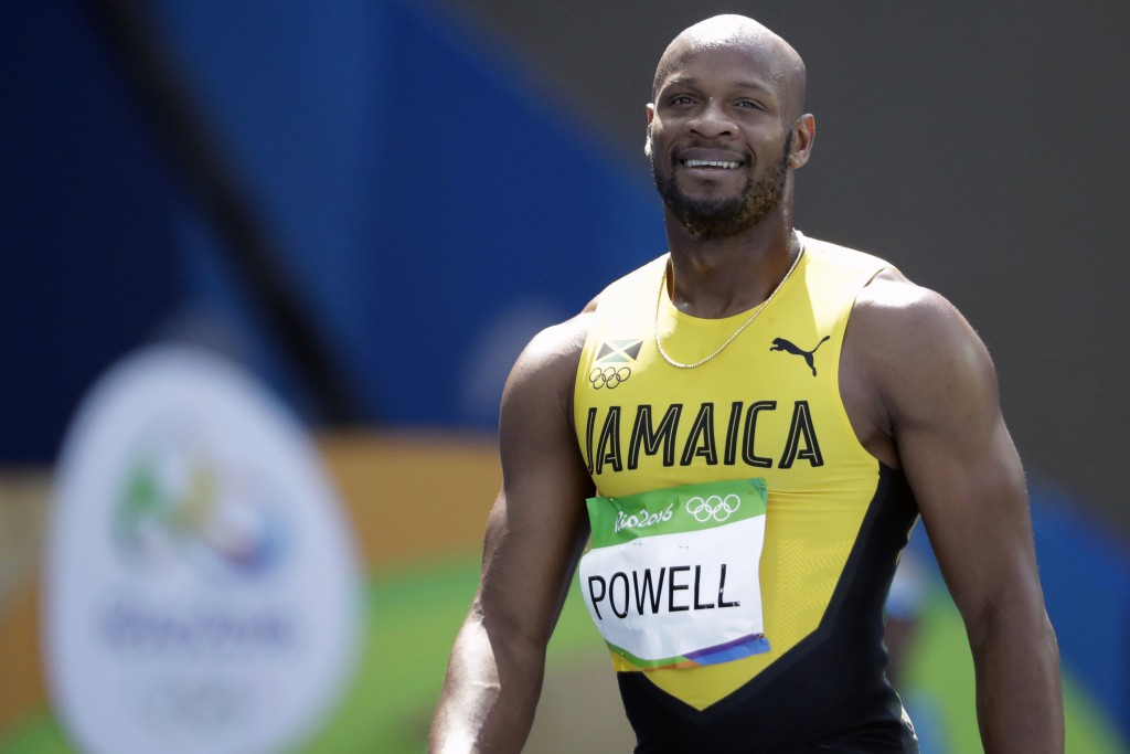 FILE - In this Aug. 18, 2016, file photo, Jamaica's Asafa Powell smiles after the men's 4x100-meter relay at the 2016 Summer Olympics in Rio de Janeir...