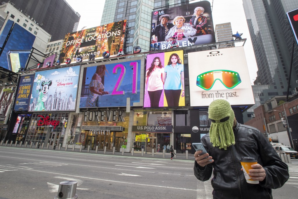 Jon Makay, of Harlem, wears an octopus hat to fend off coronavirus, Wednesday, March 25, 2020, in New York's Times Square. The number of people hospit...