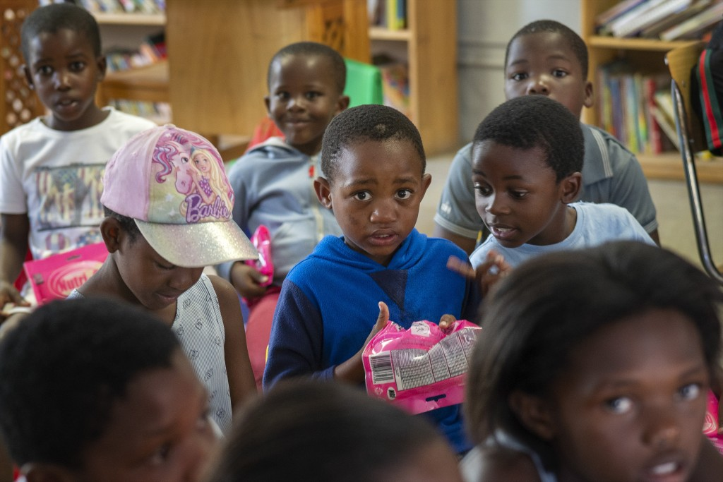 Children participate in a coronavirus awareness workshop held at the Qalakabusha center in the township of Soweto, near Johannesburg, South Africa, Th...
