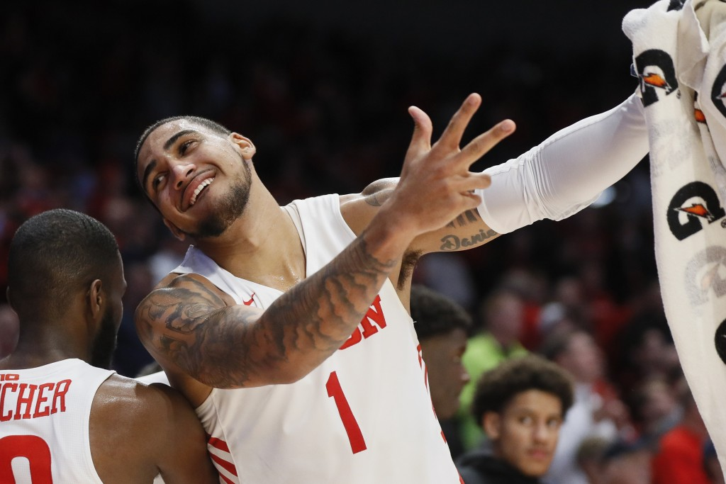 FILE - In this Jan. 14, 2020, file photo, Dayton's Obi Toppin (1) celebrates during the second half of the team's NCAA college basketball game against...