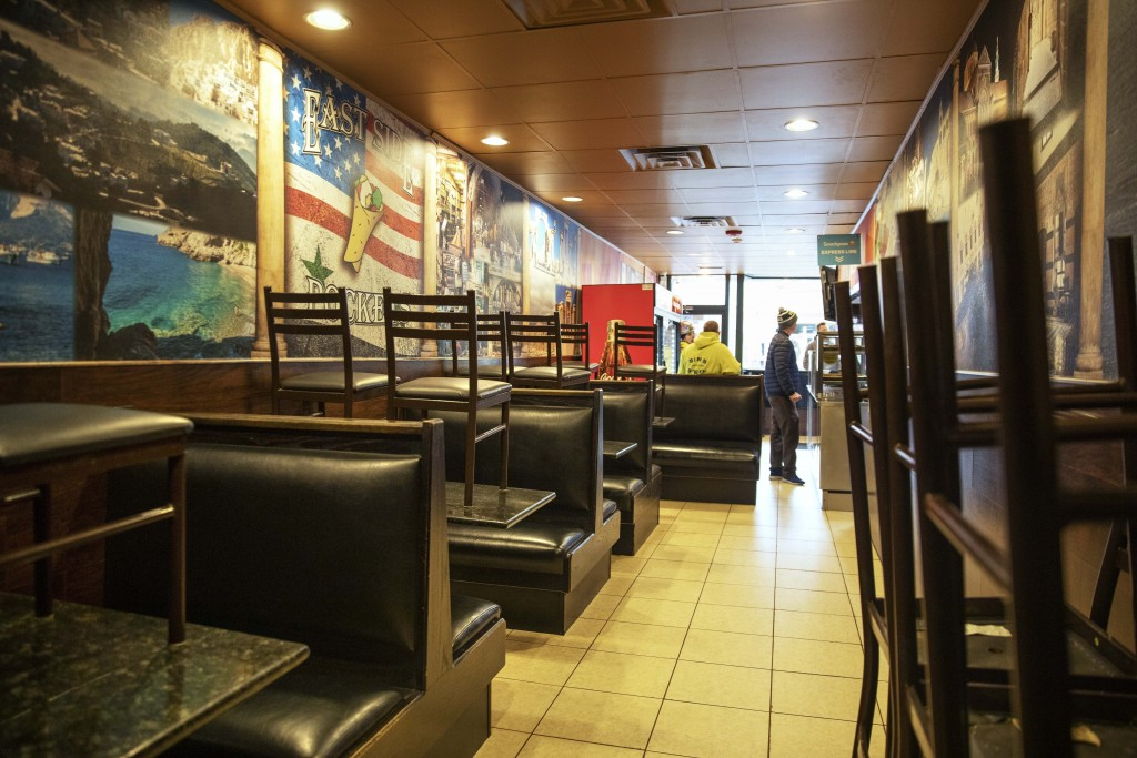 The dining section is closed off at East Side Pockets, a small restaurant near Brown University, Wednesday, March 25, 2020, in Providence, R.I. Presid...