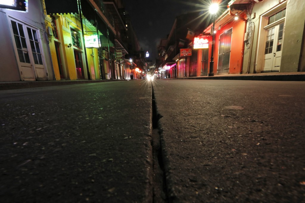 FILE - In this Thursday, March 19, 2020, file photo, a view of the nearly deserted scene on Bourbon Street, which is normally bustling with tourists a...