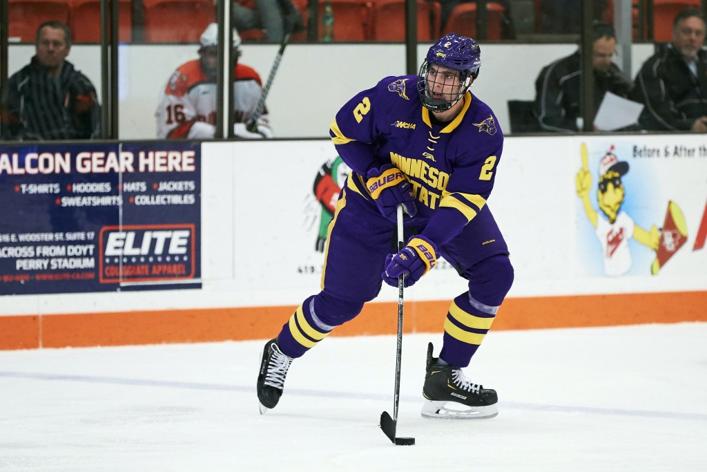 FILE - In this Dec. 15, 2018, file photo, Minnesota State defenseman Connor Mackey (2) skates with the puck against the Bowling Green during an NCAA c...
