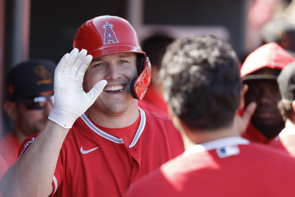 FILE - In this Feb. 25, 2020, file photo, Los Angeles Angels' Mike Trout smiles after scoring during the first inning of a spring training baseball ga...