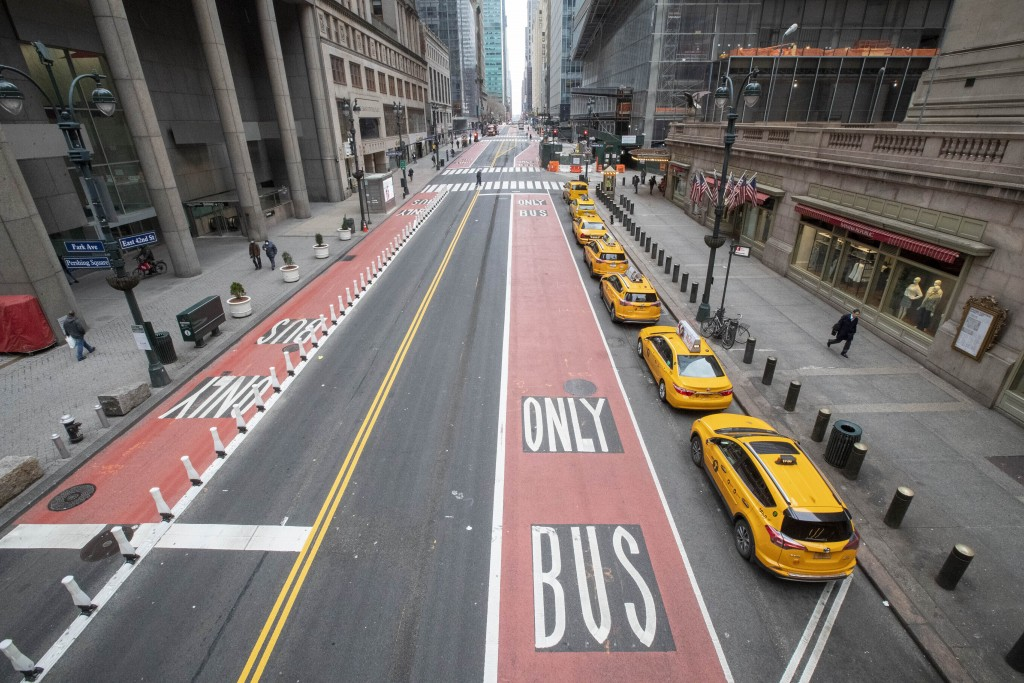 FILE - In this March 25, 2020, file photo, yellow cabs line an empty 42nd St. waiting for fares outside Grand Central Terminal, in New York. For the m...
