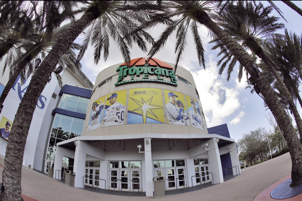In this image taken with a fisheye lens, Tropicana Field, the home of the Tampa Bay Rays, is deserted Thursday, March 26, 2020, in St. Petersburg, Fla...