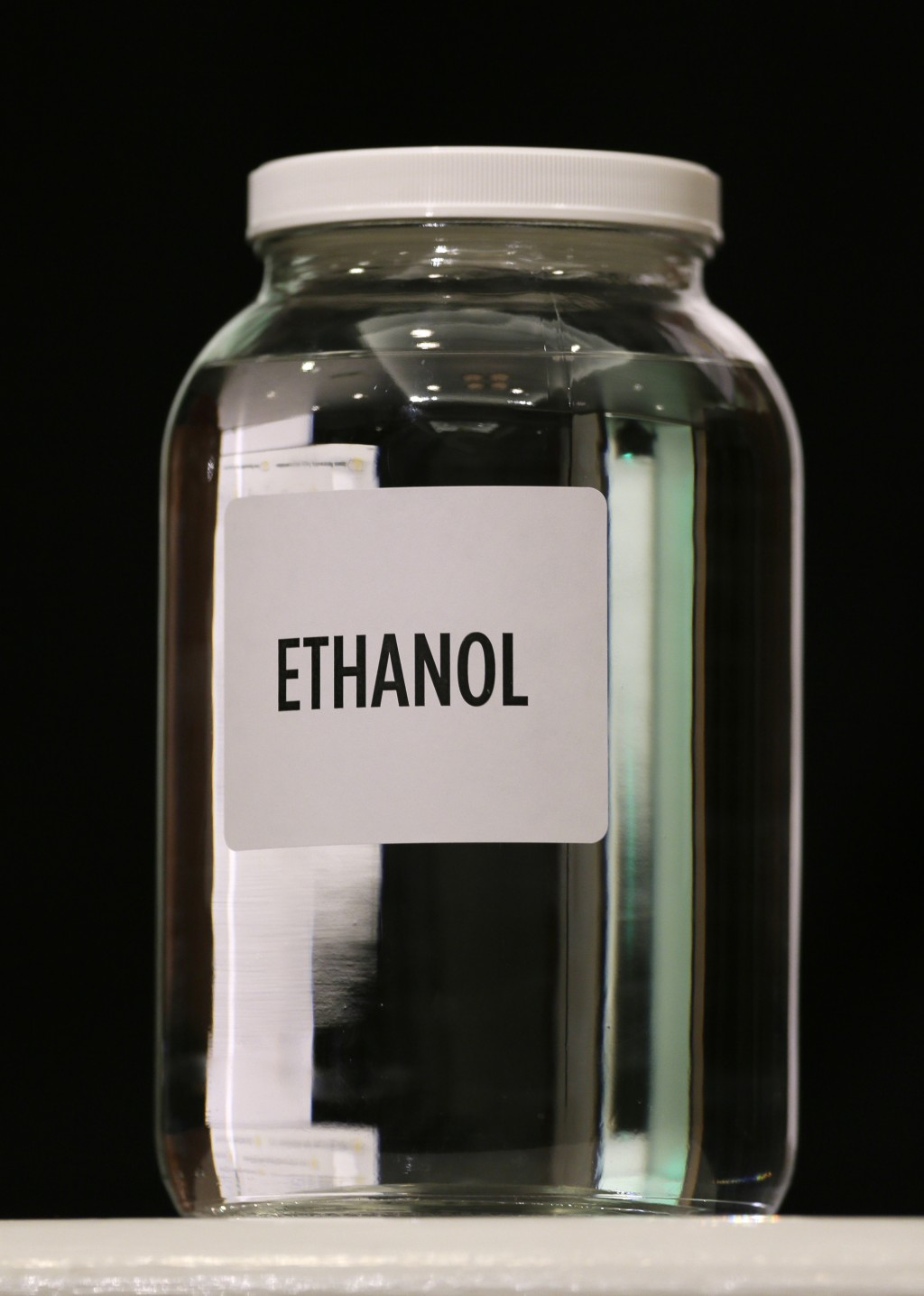 FILE— In this Jan. 28, 2014 file photo a jar of ethanol fuel sits on display during the Iowa Renewable Fuels Association meeting in Altoona, Iowa. As ...