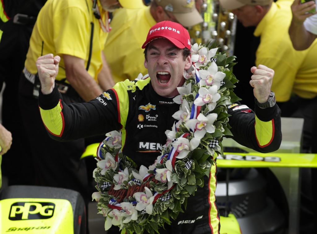 FILE - In this May 26, 2019, file photo, Simon Pagenaud, of France, celebrates after winning the Indianapolis 500 IndyCar auto race at Indianapolis Mo...