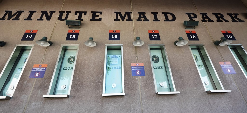 Box office windows remain closed at Minute Maid Park, March 25, 2020, in Houston. The Houston Astros would have hosted the Los Angeles Angels in their...