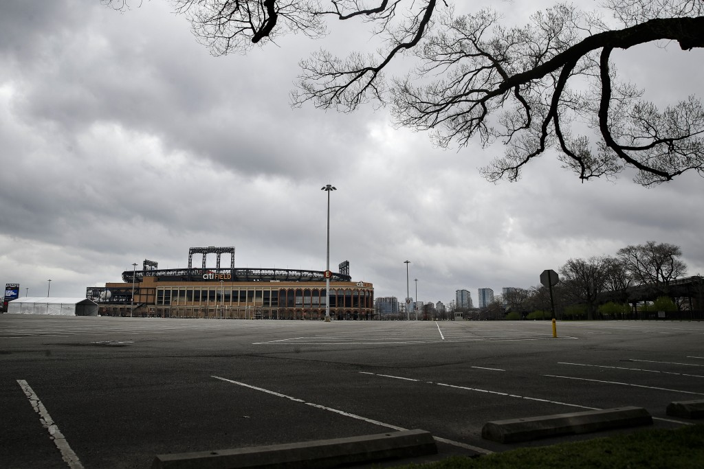 Parking lots sit empty surrounding Citifield, the home of the New York Mets, Wednesday, March 25, 2020, in the Queens borough of New York. (AP Photo/J...