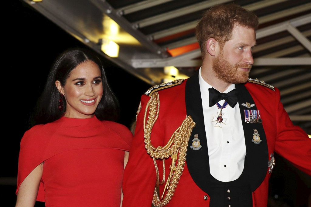 FILE - In this Saturday March 7, 2020 file photo, Britain's Prince Harry and Meghan, Duchess of Sussex arrive at the Royal Albert Hall in London. Megh...