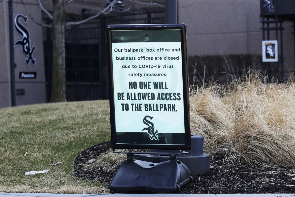A sign stands in front of the Guaranteed Rate Field, home of the Chicago White Sox in Chicago, March 25, 2020. (AP Photo/Nam Y. Huh)