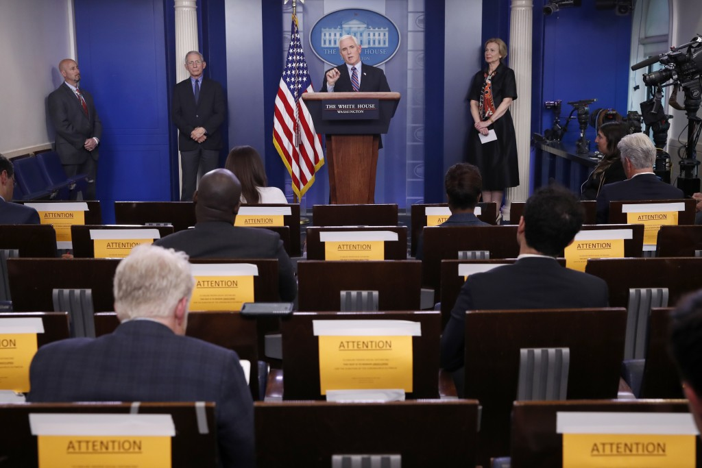 Vice President Mike Pence speaks about the coronavirus in the James Brady Briefing Room, Thursday, March 26, 2020, in Washington, as Dr. Anthony Fauci...
