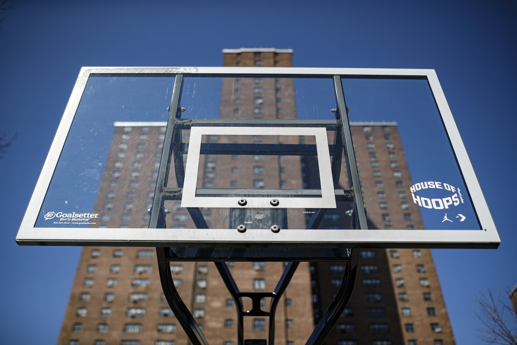 Basketball backboards stand without hoops after city officials had them removed to reduce gatherings at Holcombe Rucker Park, Thursday, March 26, 2020...