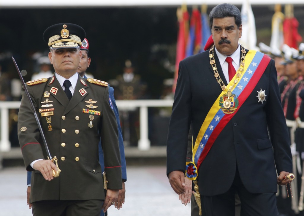 FILE - In this May 24, 2018 file photo, Venezuela's President Nicolas Maduro, right, walks with his Defense Minister Vladimir Padrino Lopez as they re...