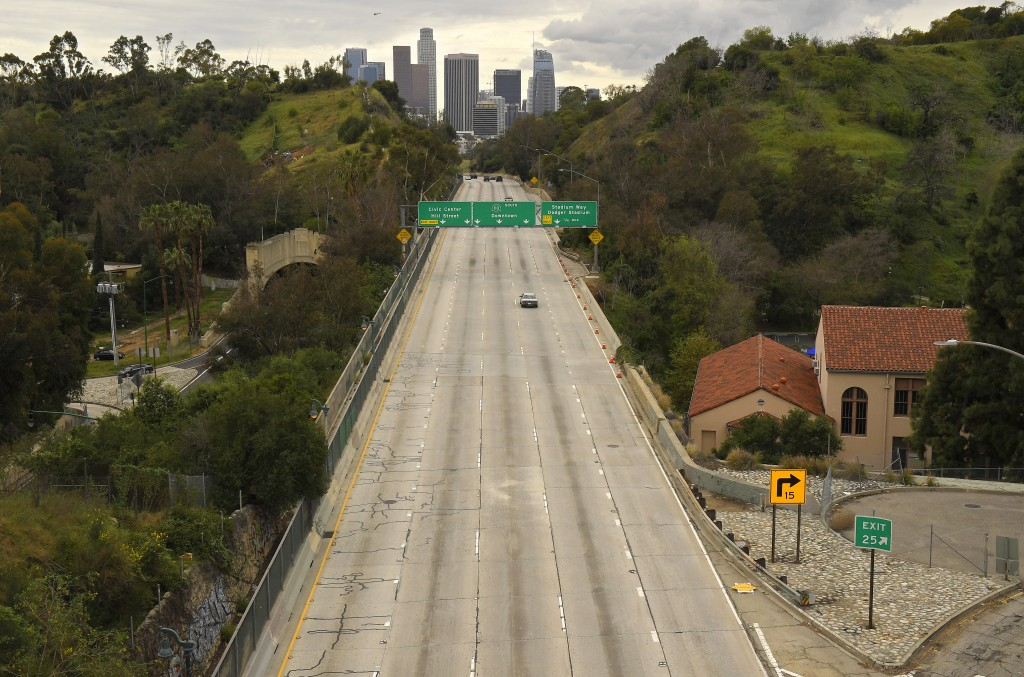 FILE - In this March 20, 2020 file photo, extremely light traffic moves along the 110 Harbor Freeway toward downtown mid afternoon, in Los Angeles. Fo...