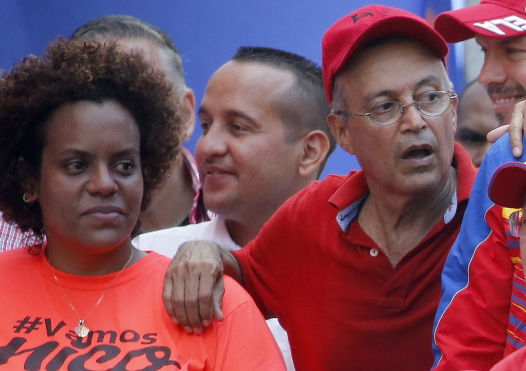 FILE - In this April 6, 2019 file photo, Luis Alfredo Motta Dominguez, right, attends a pro-government rally in Caracas, Venezuela. On Thursday, March...