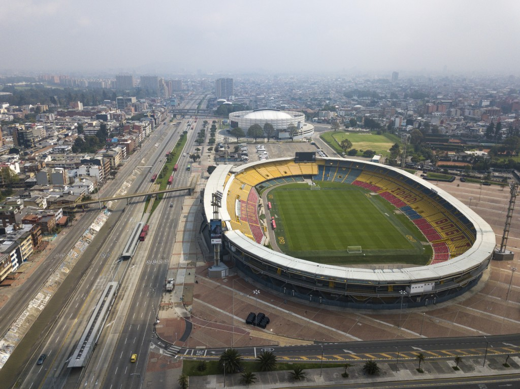 The usually busy avenue running along Nemesio Camacho stadium is empty in Bogota, Colombia, Friday, March 20, 2020. Residents in the capital of Colomb...