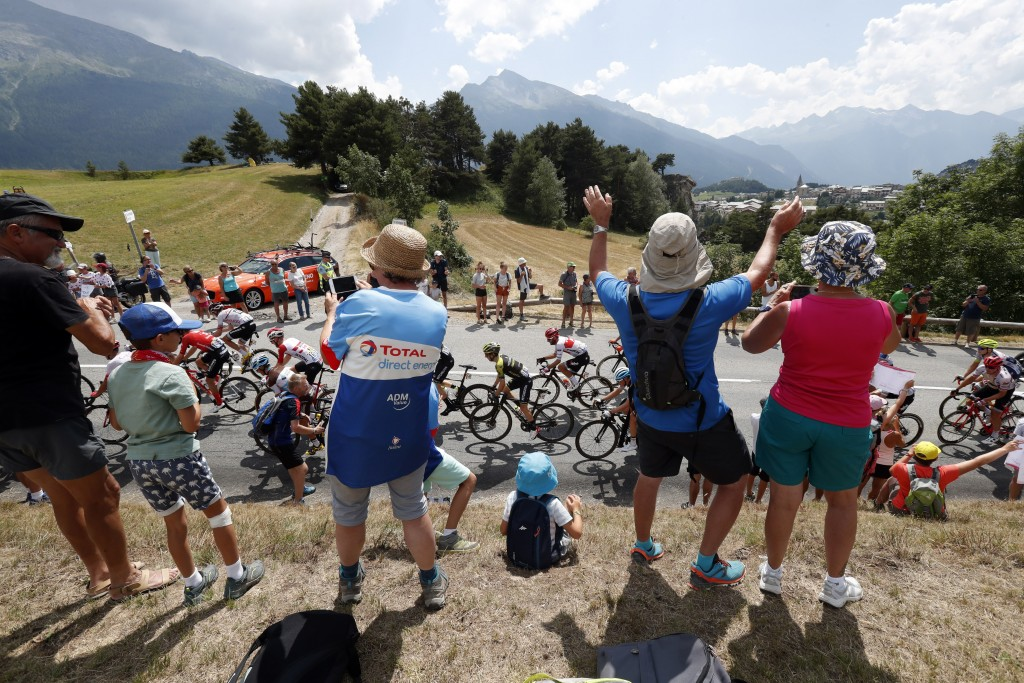 FILE - In this file photo taken on July 26, 2019 spectators along the road applaud the riders during the nineteenth stage of the Tour de France cyclin...