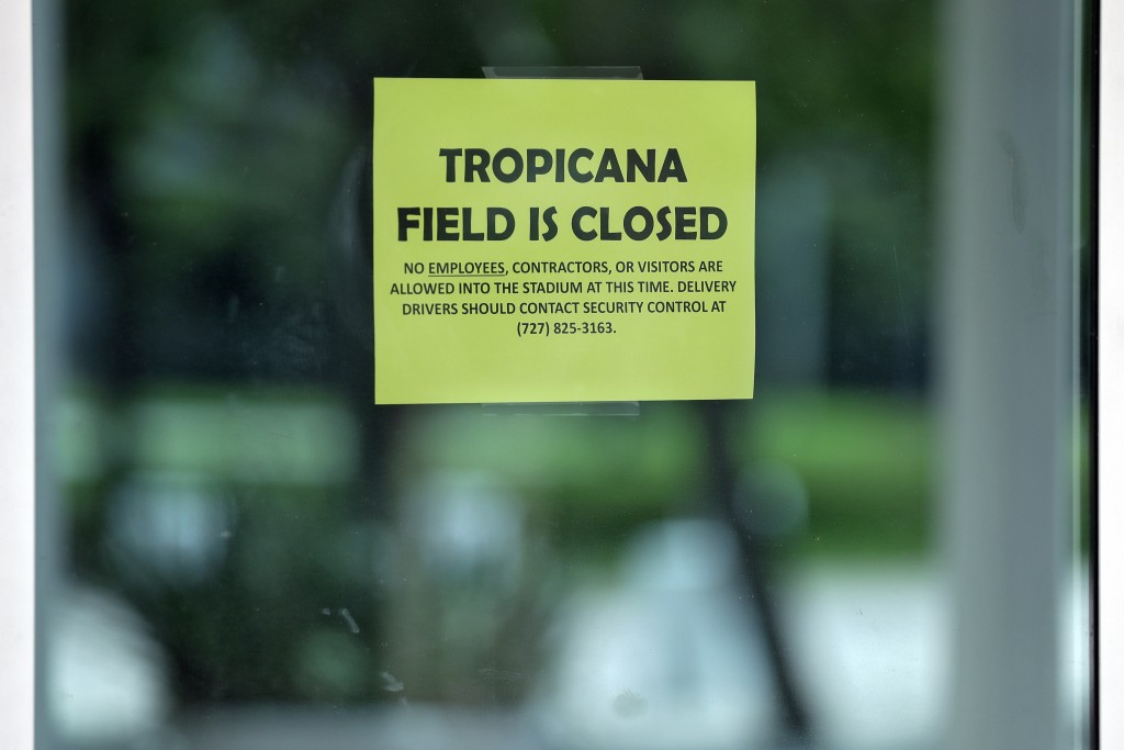 A closed sign is posted on the door at Tropicana Field, the home of the Tampa Bay Rays, Thursday, March 26, 2020, in St. Petersburg, Fla. Major League...