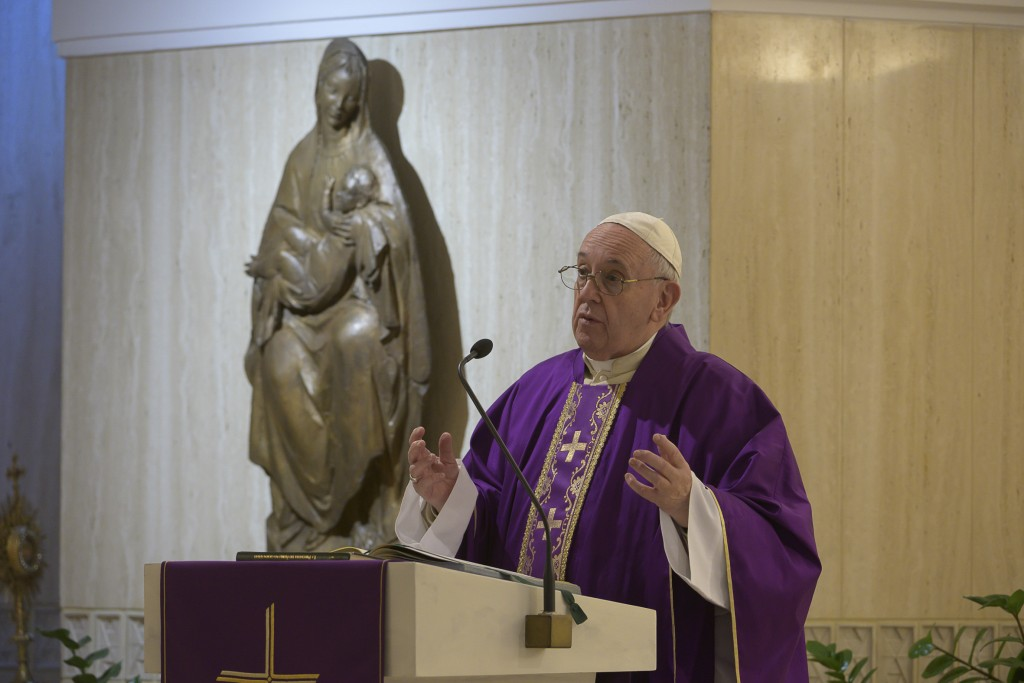 Pope Francis celebrates Mass at his Santa Marta residence, at the Vatican, Friday, March 27, 2020. The new coronavirus causes mild or moderate symptom...