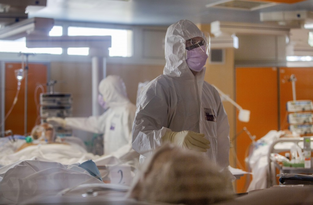 Medical staff at the intensive care unit of the Casalpalocco COVID-19 Clinic on the outskirts of Rome tend to patients, Wednesday, March 25, 2020. (AP...