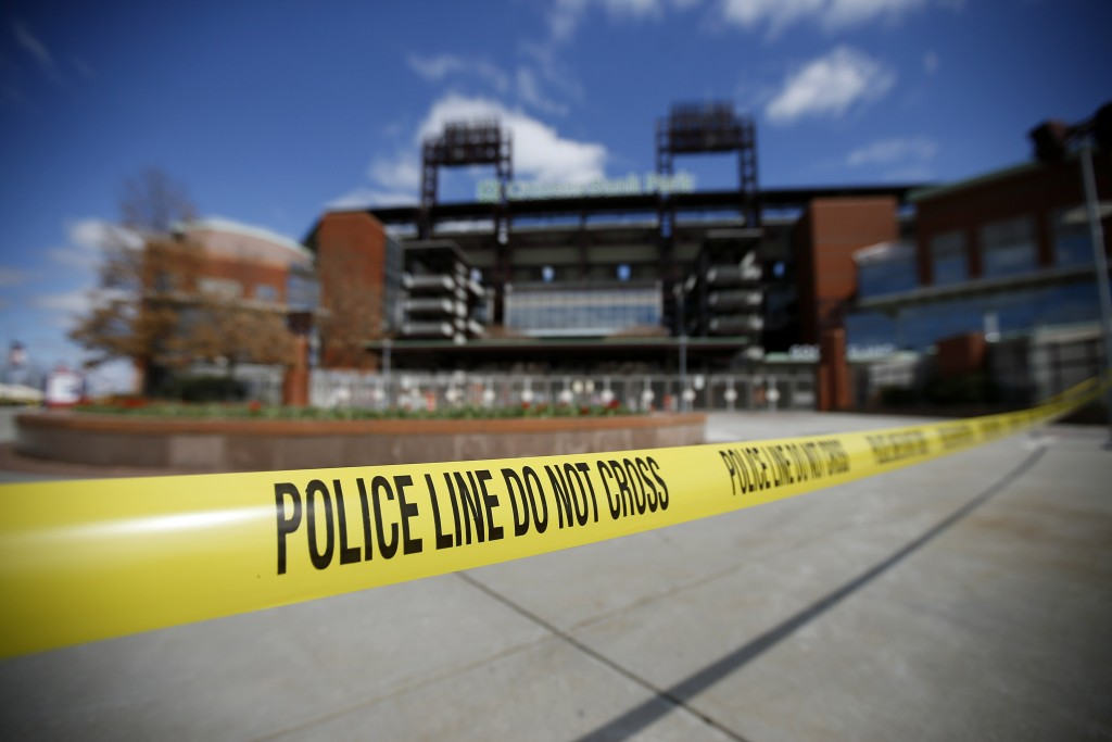 Police tape blocks an entrance to Citizens Bank Park, home of the Philadelphia Phillies baseball team, Tuesday, March 24, 2020, in Philadelphia. (AP P...