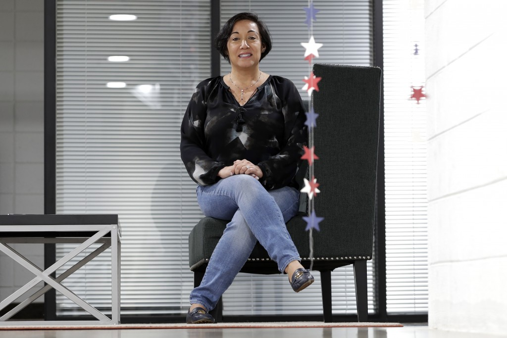 In this March 25, 2020, photo, Attorney Margarita Silva sits in her office in Phoenix. Silva was recently denied entry to a hearing inside an immigrat...