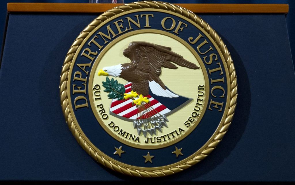 FILE - In this Nov. 28, 2018, file photo, the Department of Justice seal is seen in Washington, D.C. An internet firm is ending the automated registra...