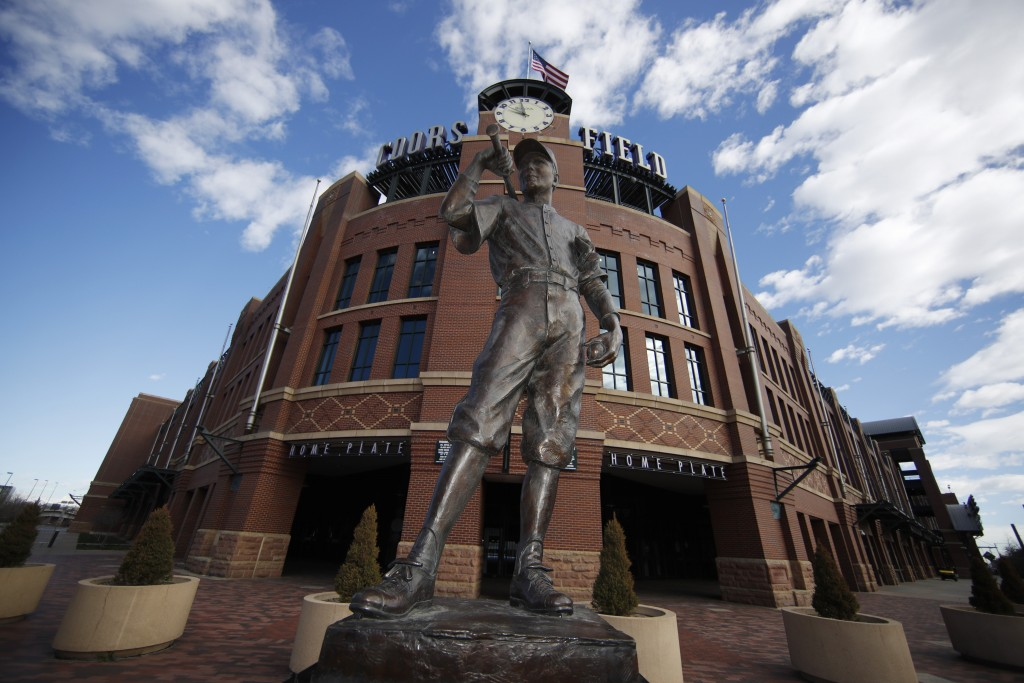 "The sculpture named ""The Player"" stands alone in front of Coors Field, home to Major League Baseball's Colorado Rockies, as individuals stay in place ..."