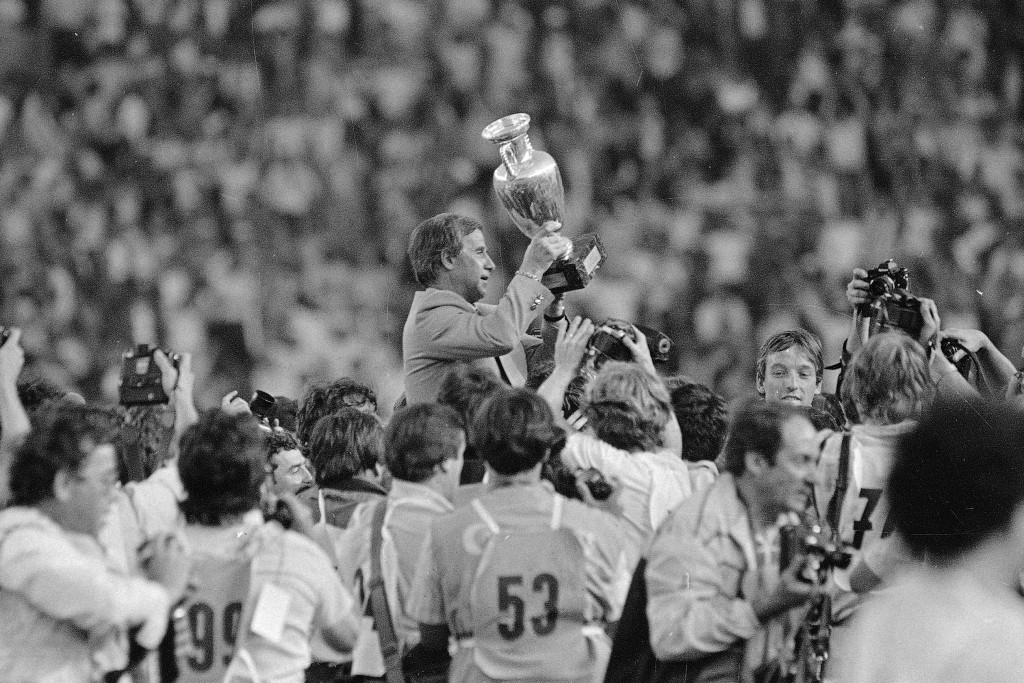 FILE - In this June 27, 1984 file photo, French soccer team coach Michel Hidalgo raises the 1984 European Championship cup as he is carried across the...